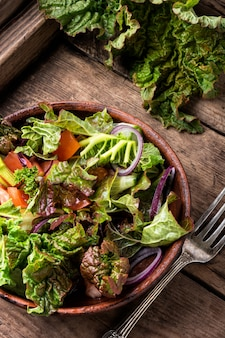 Spring salad on wooden background