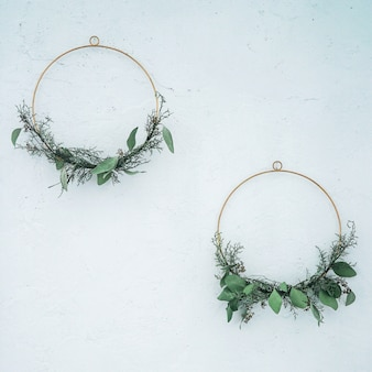Spring or summer decor on the wall, diy wreath of green branches