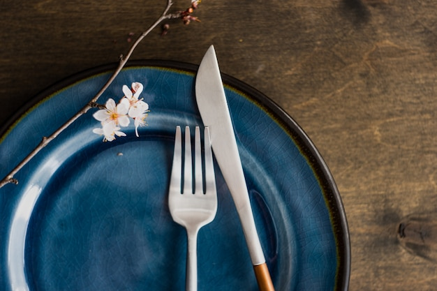 Spring table setting with blooming tree branch