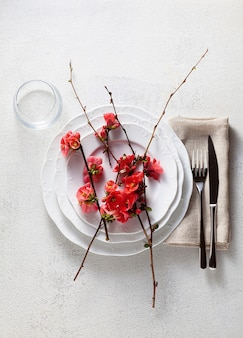 Spring table setting with flowering branches.