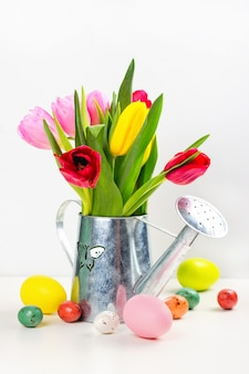 Spring tulips and easter eggs on white background