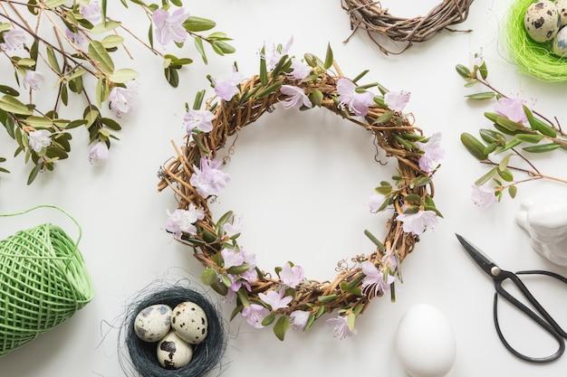 Spring wreath with flowers on light. creative flat lay. decor handmade.