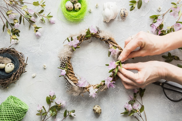 Spring wreath with flowers on light. creative flat lay. top view. decor handmade. woman decorated.