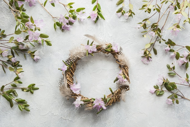 Spring wreath with flowers on light. creative flat lay. top view. decor handmade.