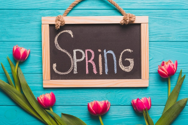 Spring writing near fuchsia tulips