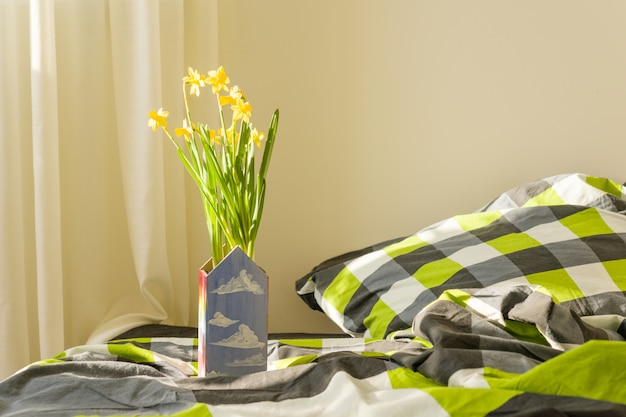 Spring yellow flowers in the interior of the bedroom