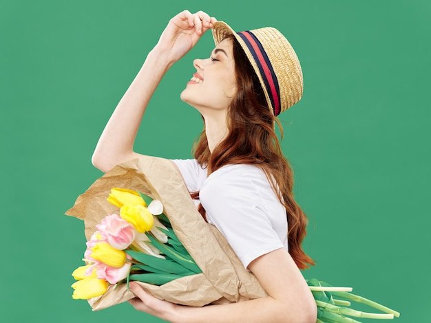 Spring young beautiful girl with flowers woman posing with a bouquet of flowers, women's day