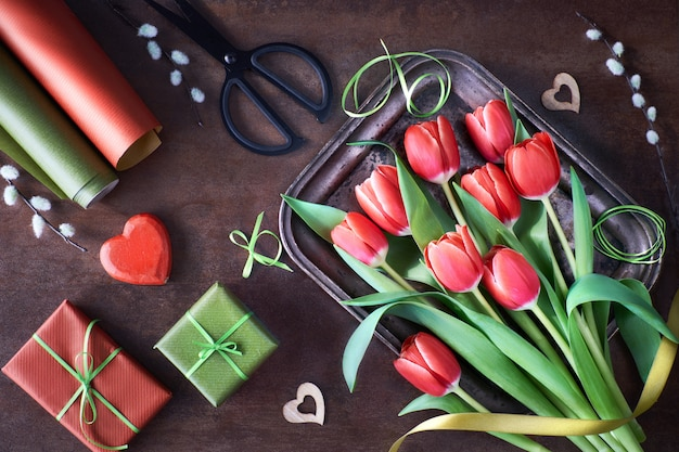 Springtime decorations with wrapped gifts, tulip flowers and hearts