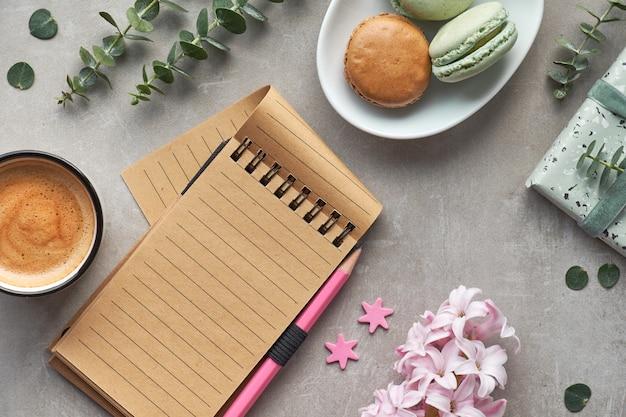 Springtime flat lay with pink hyacinth, eucalyptus, mobile phone, notebook