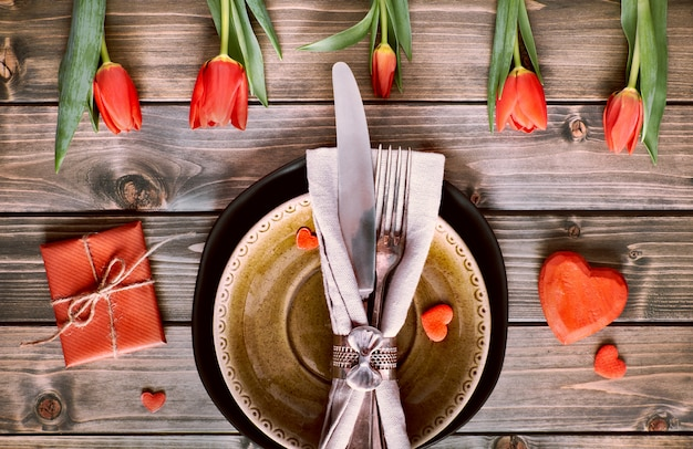 Springtime menu concept with fresh tulips and heart decoration on rustic wood