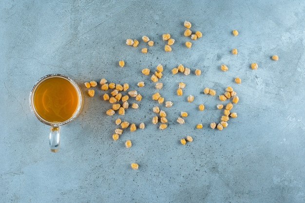 Sprinkled chickpea and glass of beer , on the marble table.