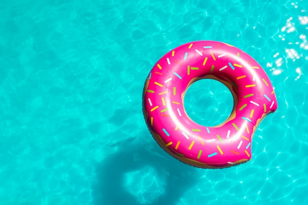 Sprinkled inflatable toy in pool bright water