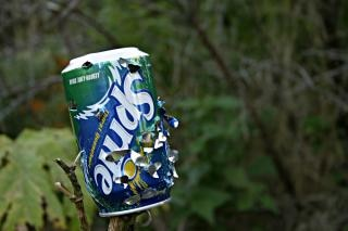 Sprite can with bullet holes, holes
