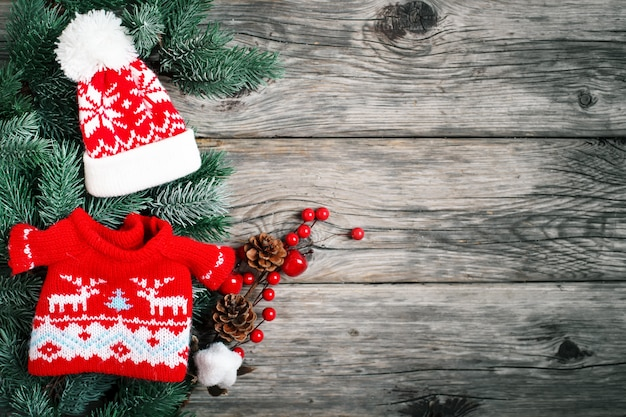 Spruce branches and christmas toys on a wooden background