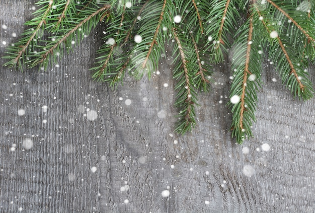 Spruce twig on oak table, christmas background. top view with copyspace