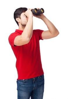 Spy using binoculars