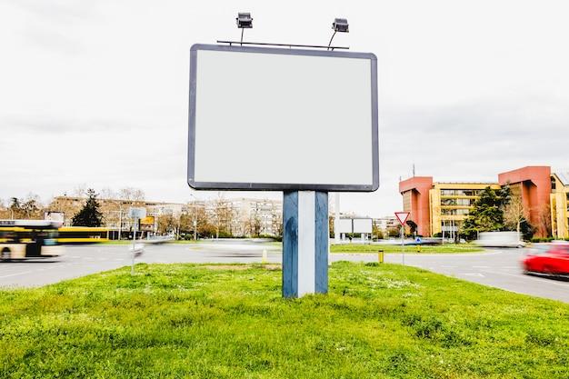 Square blank billboard on the city street