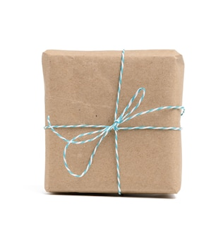 Square box wrapped in brown kraft paper and tied with rope