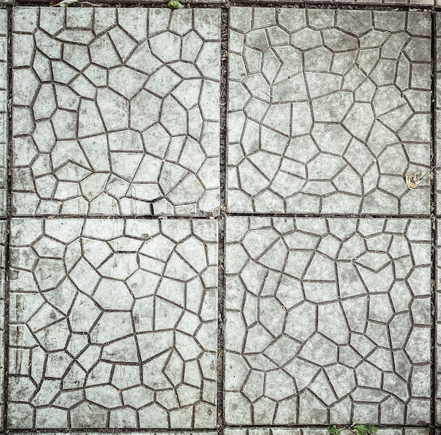 Square closeup on grey stone outdoor tile floor texture