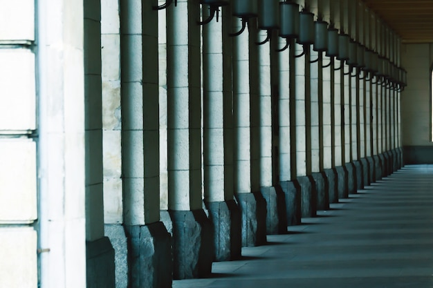 Square columns stand in a row. architecture