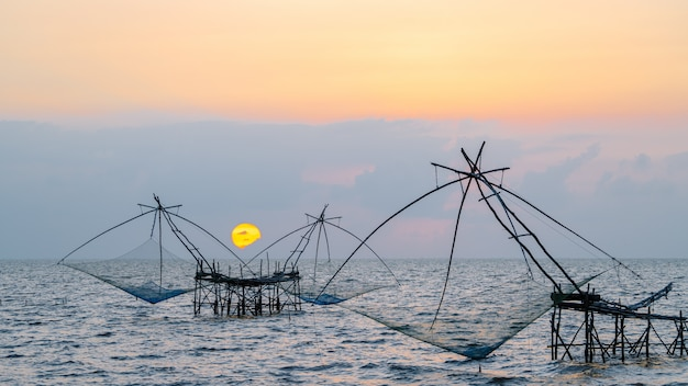Square dip net in lake with sunrise at pakpra, phatthalung, thailand