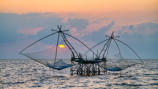 Square dip net with sunrise at pakpra, phatthalung, thailand