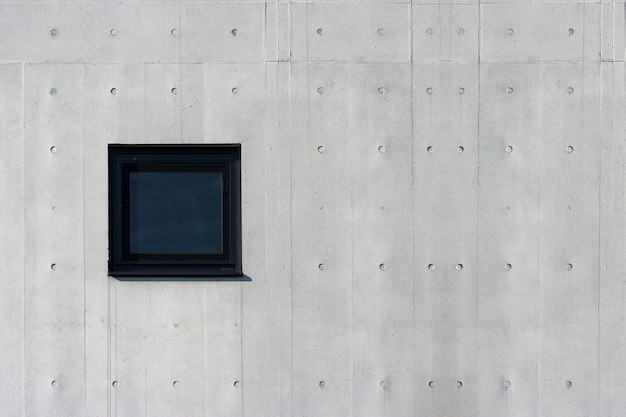 Square glass window on aged cement concrete wall background. for any vintage design work.