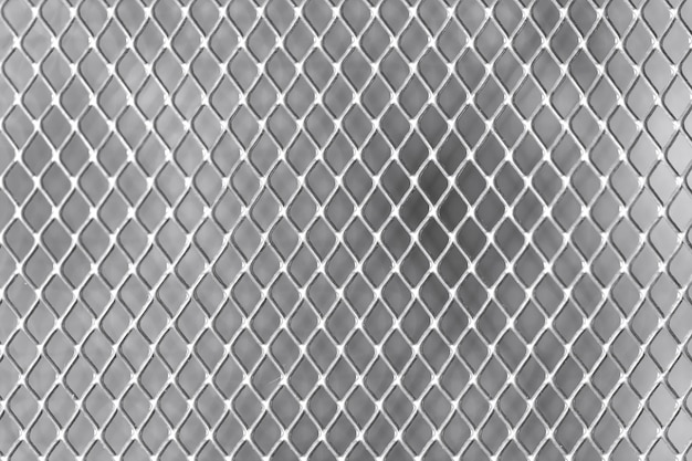 Square grid on white wall metal close-up