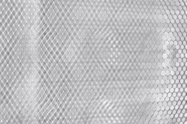 Square grid on white wall metal  closeup