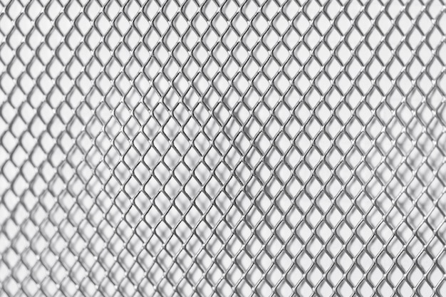 Square grid on white wall metal