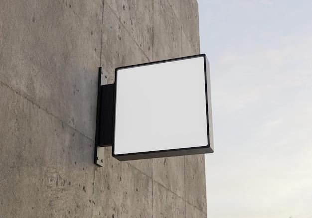 コンクリートの壁に正方形のロゴのモックアップ。 3dレンダリング
