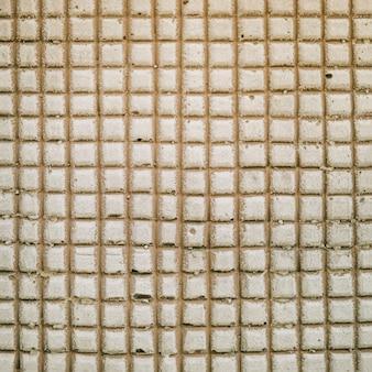 コンクリートの壁の背景に正方形のパターン