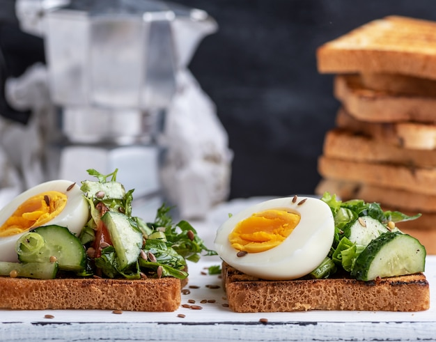 Square pieces of bread from white wheat flour with boiled egg