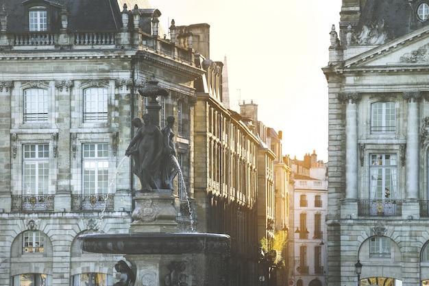 Square of place de la bourse and the three graces  fountain in bordeaux