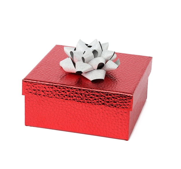 Square red shiny gift box with gray bow on white isolated background