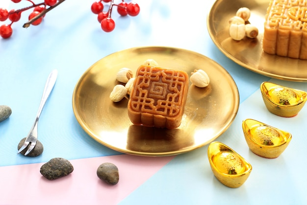 Square shape moon cake (mooncake) chinese dessert snack during lunar new year mid autumn festival. concept white asian bakery, served with tea. copy space for text or advertisement