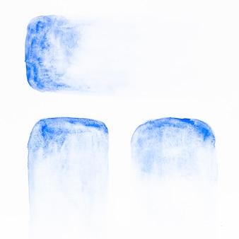 青色の塗料の四角い汚れ