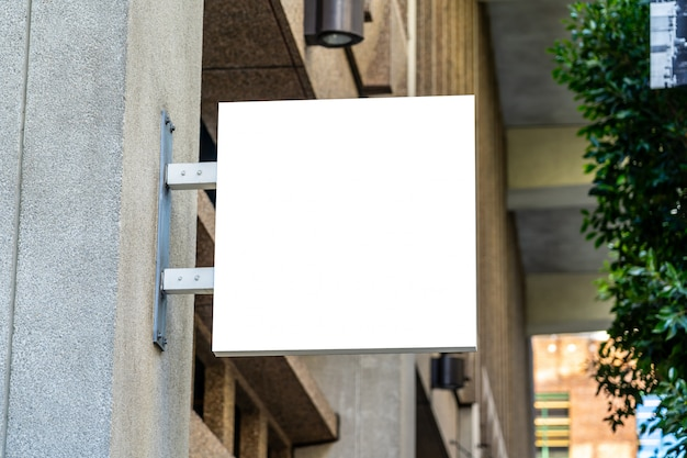 Square white company sign concept on marble