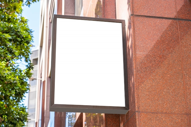 Square white company sign concept on a modern palace