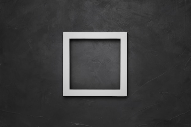 Square white empty frame on gray textured background with copyspace