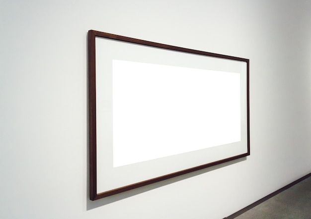 Square white surface with dark frames attached to a wall in a room