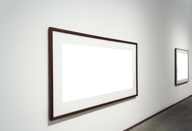 Square white surfaces attached to a wall in a room
