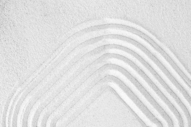 Sfondo quadrato di sabbia zen nel concetto di consapevolezza