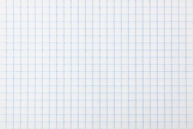 Квадратная клетчатая старая бумага в качестве фона или текстуры очень крупным планом