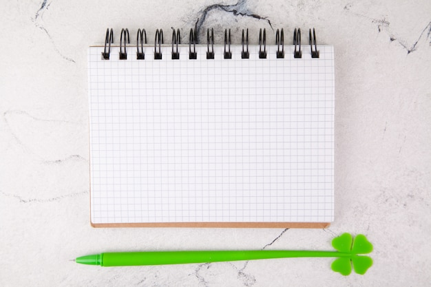 Squared notebook on a white background, decor for st. patrick's day.
