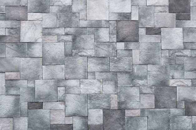 Squares background, stone wall texture, gray rock floor. monochrome granite, brick surface.