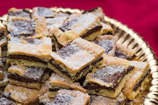 Squares of homemade chocolate tart