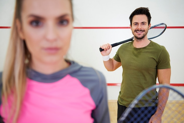 Squash players on court