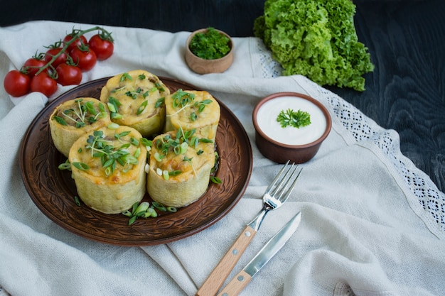 Squash stuffed with minced meat, vegetables and sprinkled with hard cheese. side view.