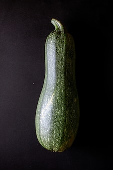 Squash vegetable marrow zucchini on black background